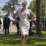 Day 3. White lace dress by Anthony Price hat by Philip Treacy.