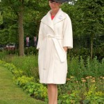 Hat by William Chambers, coat by Amanda Wakely and coral dress by Paule Ka.